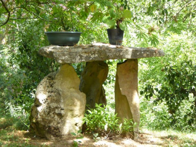 Dolmen burying stones are common in the area, but I think this gardener built his own for show - I like it!